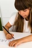 Girl writing the ABC alphabet — Stock Photo
