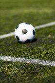 Soccer ball on artificial pitch — Stock Photo