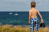 Boy with bathing shoes — Stock Photo