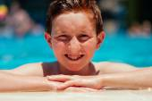 Boy at poolside — Stock Photo