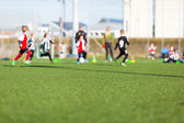 Blur of boys playing soccer — Stock Photo
