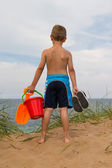 Young boy with plastic bucket — Stock Photo