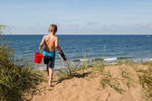 Boy with beach toys — Stock Photo