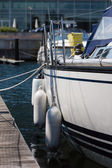 Sailing boat with bumpers — Stock Photo
