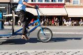 Trike in city traffic — Stock Photo