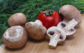 Royal mushrooms, tomato and fennel lie on the board — Stock Photo