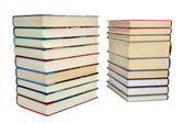Two piles of books on a white background — Stock Photo