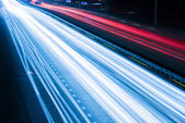 Night traffic with blurred traces from cars — Stock Photo