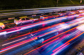 Night traffic with blurred traces from cars — 图库照片