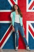 Woman and UK flag — Stock Photo