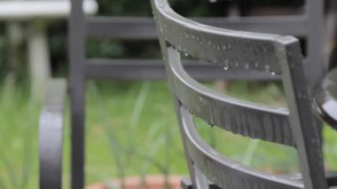 Garden Chair in the Rain — Stock Video