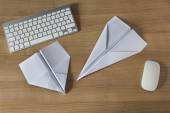 Paper Plane on an office desk — Stockfoto