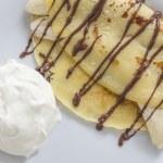 Crepe with banana and chocolate sauce — Stock Photo #66079749