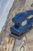Grinding machine on wood — Stock Photo