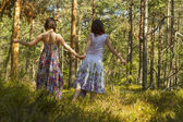 Two women walking in the forest — Stock Photo