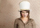 Woman in white top hat and a creative makeup — Stock Photo