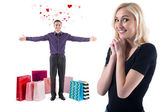 Young man with smile and flying hearts around standing bags gifts presents after shopping congratulate happy gorgeous girl — Stock Photo