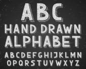 Vector hand drawn doodle sketch alphabet letters written with a chalk on blackboard or chalkboard — Vetor de Stock
