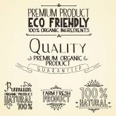 Premium quality organic health food headings natural product nature-themed badges and labels with green leaves hand draw handwritten text — Stok Vektör
