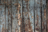 Old damaged wooden wall or fence aged and weathered. — Stock Photo