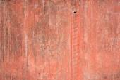 Red old vintage aged cement street rusty grunge rough wall surface background. — Stock Photo