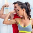 Active athletic sportive woman girl and man showing their muscles biceps healthy lifestyle — Stock Photo #70479991
