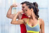 Active athletic sportive woman girl and man showing their muscles biceps healthy lifestyle — Stock Photo