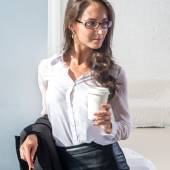 Woman in glasses with the cup of coffee or tea office — Stock Photo