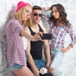 Two women and man friends taking selfie together wearing summer clothes  jeans shorts jeanswear street urban casual style having fun. — Stock Photo #71295827
