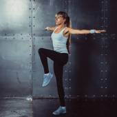 Fitness, sport concept woman working out and standing in yoga pose — Stock Photo