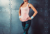 Sportswoman showing perfect female body in sports clothing sportswear concept sport healthy lifestyle. — Stock Photo