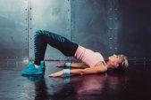 Bridge pose sporty woman doing fitness workout yoga stretching gymnastics exercise. — Stockfoto
