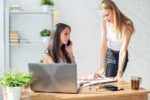 Businesswoman talking and showing something to colleague in office — Stock Photo