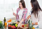 Gorgeous young Women preparing dinner in a kitchen concept cooking, culinary, healthy lifestyle. — Stock Photo