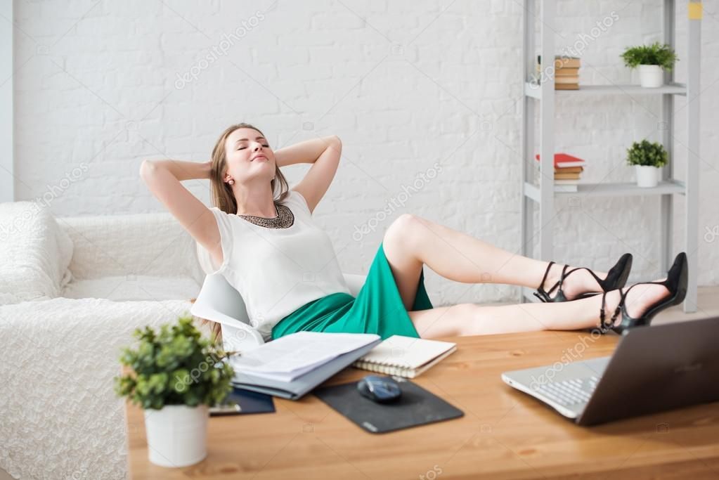 Businesswoman Resting Relaxing Legs On The Table Hands