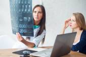 Doctor and patient looking at x-ray — Stock Photo