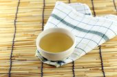 Japanese tea on a bamboo background. — Stock Photo