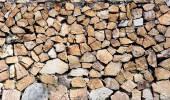Povrch hnědá kamenné zdi. — Stock fotografie