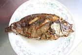 Fried fish on a dish. — Stock Photo