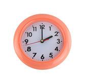 Orange wall clock isolated on white. — Stock Photo
