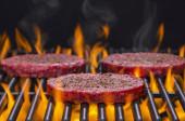 Hamburgers on a Hot Flaming BBQ Grill — Stock Photo