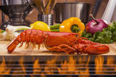 Fresh steamed lobster with lemon and vegetables — Stock Photo