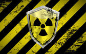 Nuclear shield vector background with grunge elements — Stock vektor