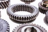 Large group of rusty transmission gears on a white background. — Stock Photo