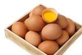 A broken egg in a number of eggs — Stock Photo