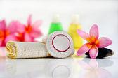 Toiletries with plumeria flower — Stock Photo