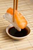 Sushi with chopsticks — Stock Photo