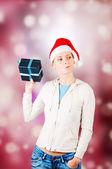 Woman holds  giftbox — Stock Photo