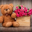 Roses and teddy bear — Stock Photo #63308147