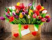 Colorful tulips in wooden box — Stock Photo